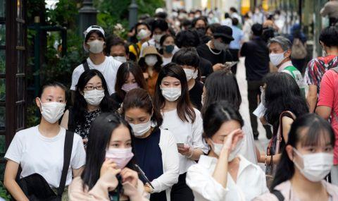 Заради пандемията: японският премиер Суга се оттегля - 1