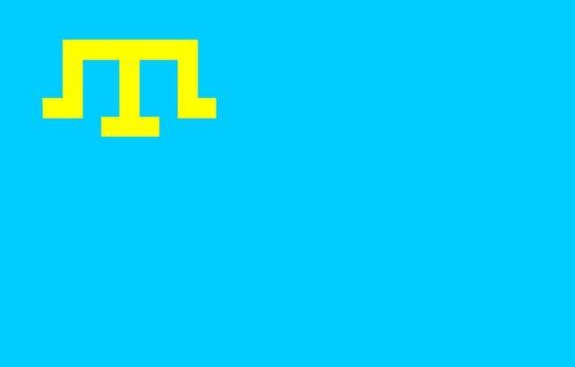 Кримските татари целуват своето знаме, докато ситуацията в окупирания Крим е мрачна