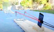Странен експеримент: iPhone 12 Pro Max, изстрелян от прашка по стъкло (ВИДЕО)