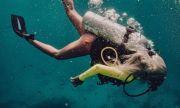 Андреа не спира с фотошопа и под водата